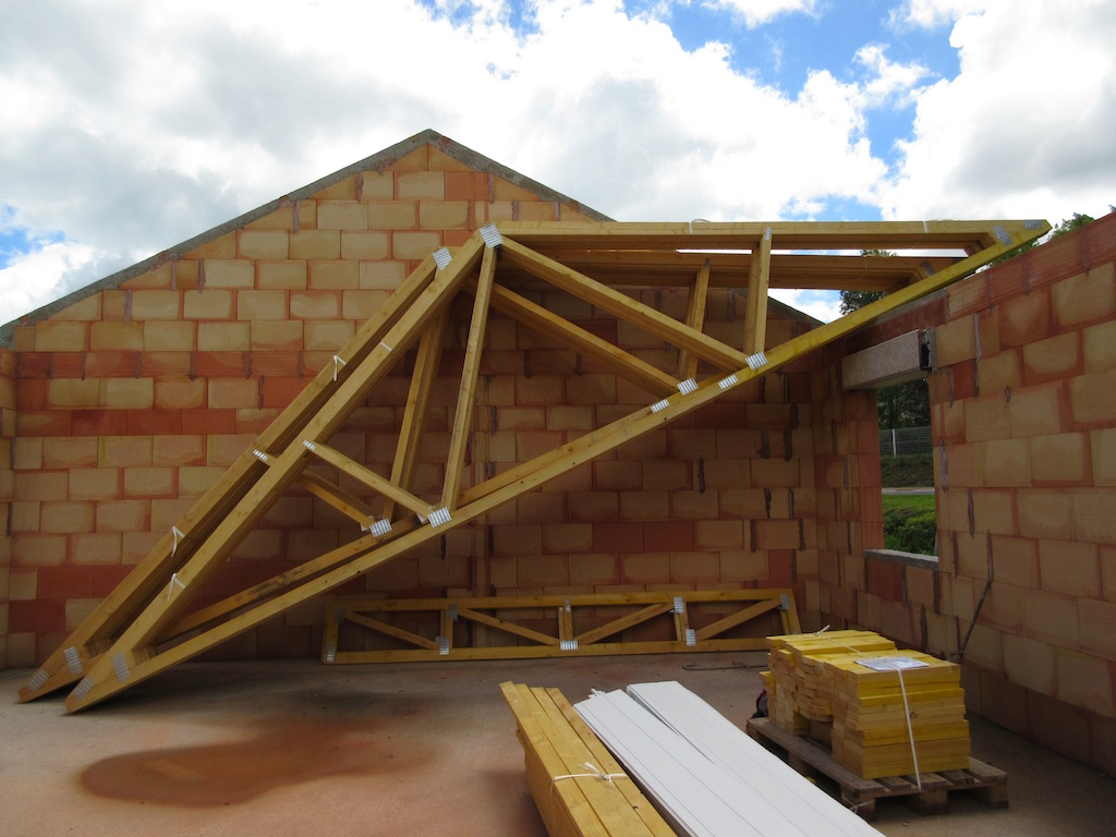 We made it house 5 2 2 love allier for Pre made roof trusses